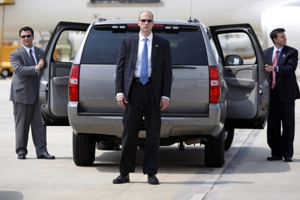 Secret Service agents await the arrival of U.S. Presidential candidate Obama in Durham
